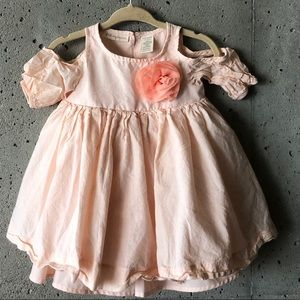 Adorable peach dress with flower